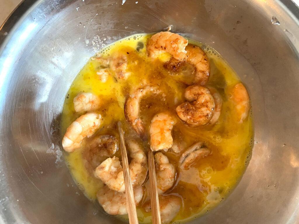 mix shrimp with beaten egg