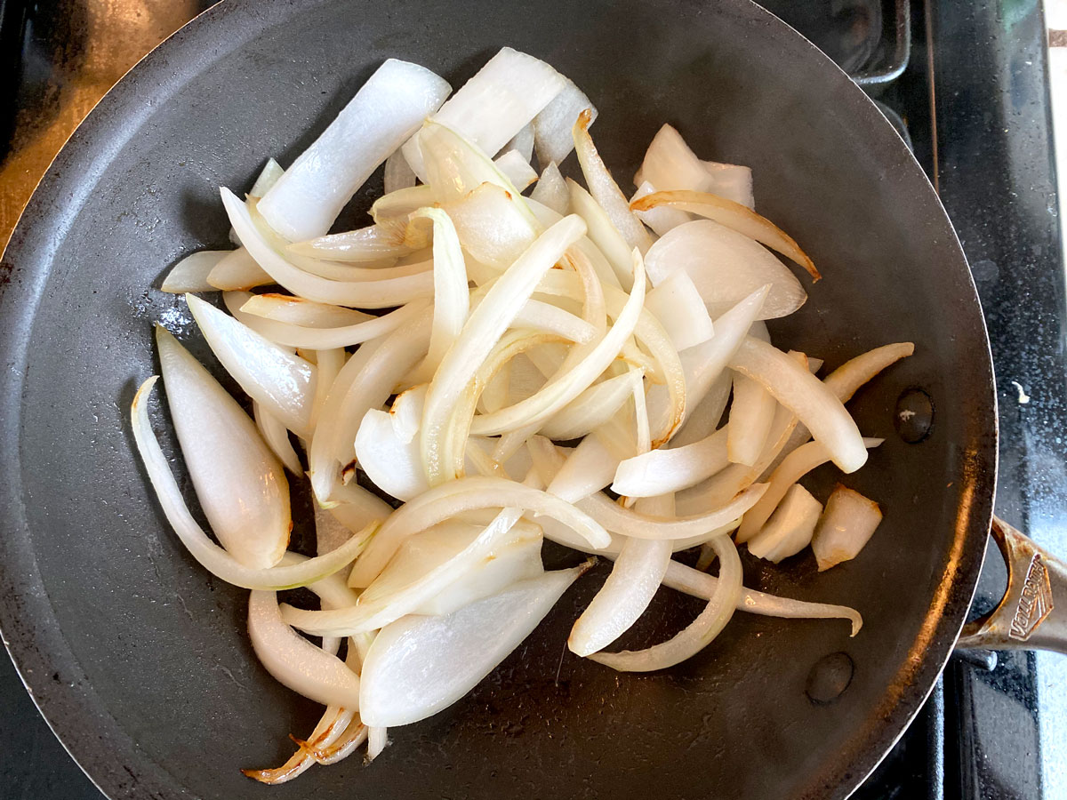 sliced onions in pan