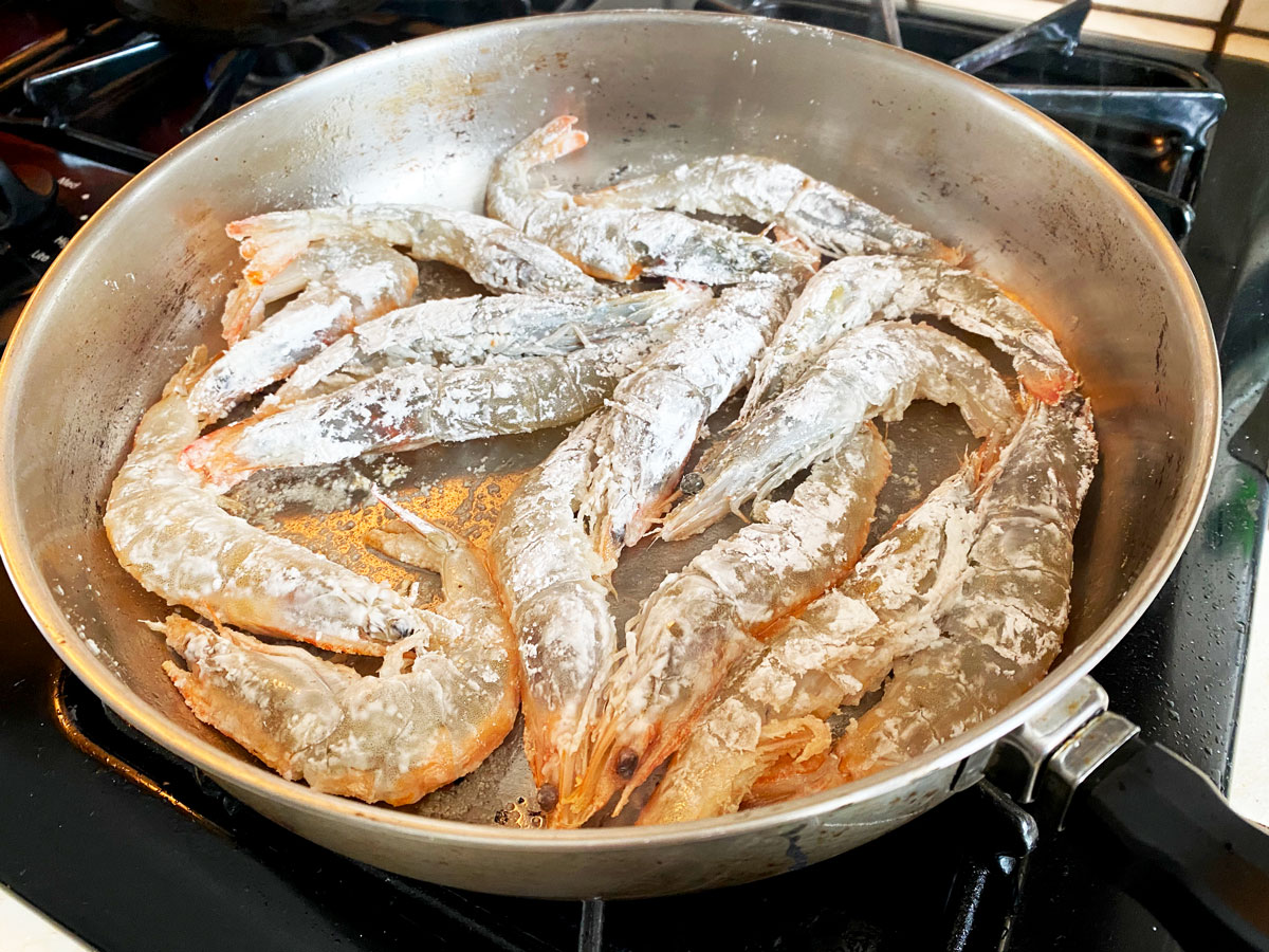 shrimp fried in a pan with cornstarch