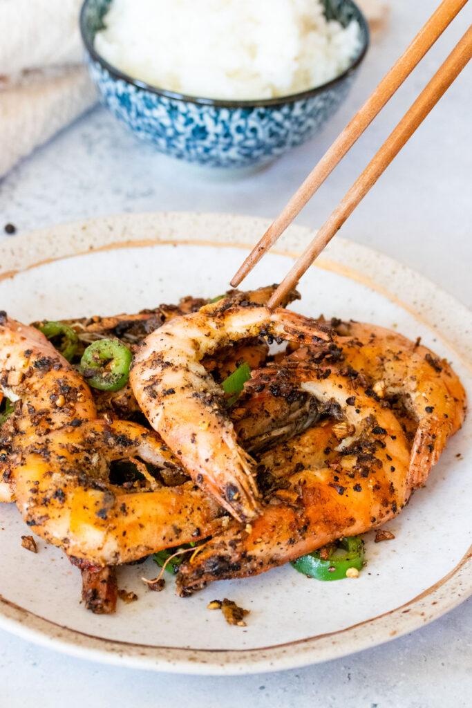 chopsticks picking up salt and pepper shrimp