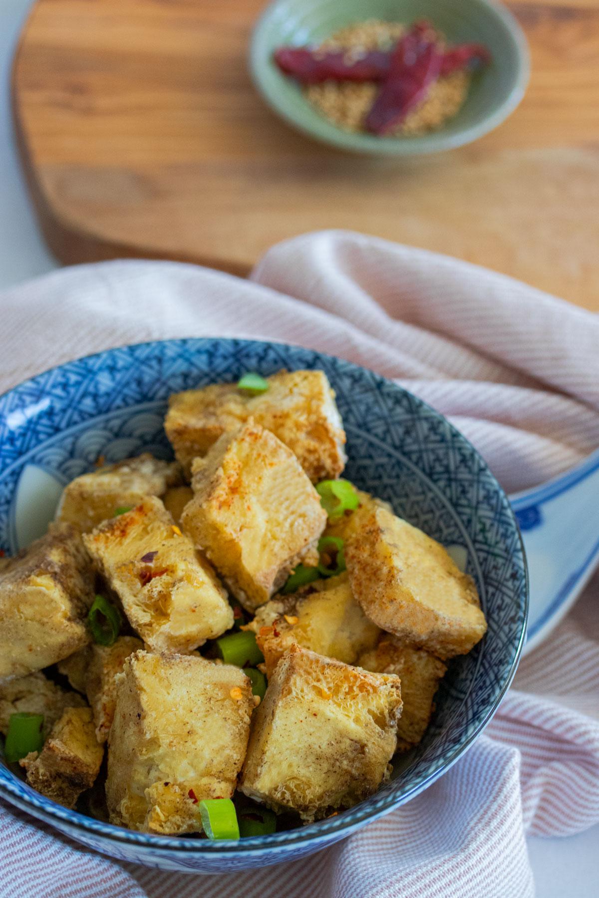 salt and pepper tofu in blue bowl