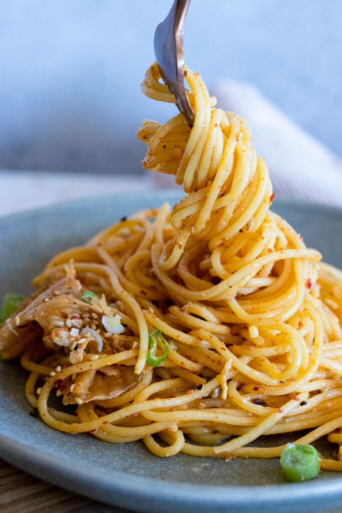 creamy kimchi pasta on fork